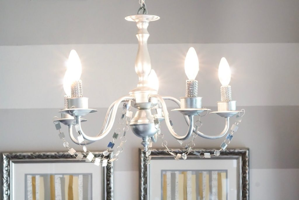 Give your dated chandeliers a face lift with this easy, inexpensive tutorial using Rub N'Buff was in pewter.