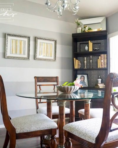 dining room table and chairs. book case. gray striped wall