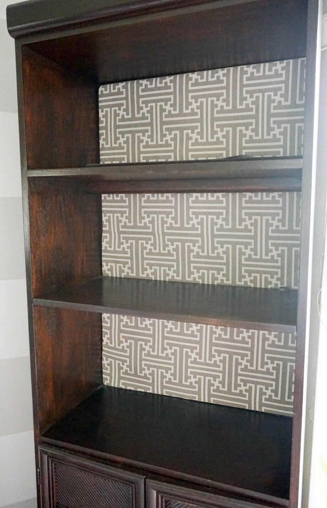 After staining with General Finishes Gel Stain in Java, I covered the back of the bookcase with this geo damask fabric.